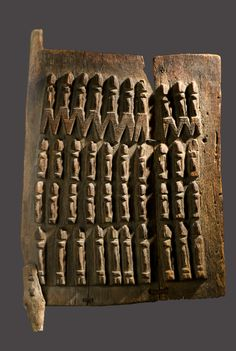 Africa | Granary door with Nommo ancestor figures from the Dogon people of Mali | Wood  || March 2014 Catalogue, pg 13
