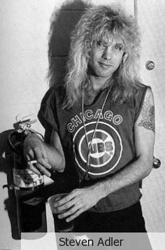 Steven Adler: I find this quite ironic given that he is smoking near a fire extinguisher...