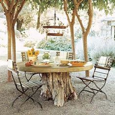 Dine Al Fresco Turn a tree stump into a dining table. Slice it level at about 28 inches tall, and crown it with a DIY poured concrete top. Tree Table, Log Table, Picnic Table, Rustic Table, Tree Stump Table, Rustic Wood, Tree Stump Decor, Table Bases, Picnic Area