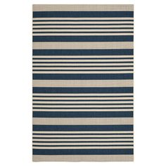 Anchor your patio seating group or define space in the den with this artfully loomed indoor/outdoor rug, featuring grey and bone-hued stripes for timeless st...