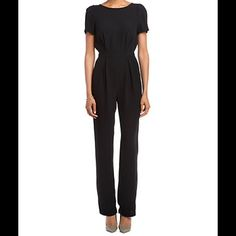 NEW A.B.S. By Allen Schwartz Black JUMPSUIT XS NWT New with tags A.B.S  BY Allen Schwarts Woven Playsuit Jumpsuit ROMPER. Size XS . Rounded neckline. Gentle pleating complements the banded stretch waist. Button-and-loop secures the single strap at the nape. Concealed side zip closure. 100% polyester. Dry clean only. Made in the U.S.A and Imported. Measurements: Inseam: 32 in ABS Allen Schwartz Pants Jumpsuits & Rompers