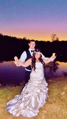 Beautiful married couple! #nightwedding #bridalmakeup #weddingphotography #bridalhair #bohemian #pinkpewter #headband #handsomegroom #weddinghair #weddingmakeup #brideandgroom #beautifulbride #longhair #bridalphotography #rusticwedding #weddingatwater #weddingsunset #weddingdress