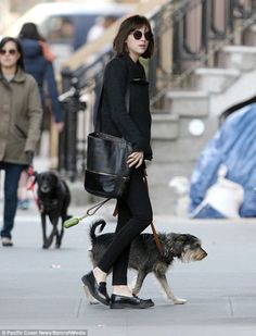 Retro: Dakota Johnson looked beatnik chic in New York as she walked her dog a day after chopping her hair off