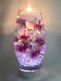 Decoration: Pink orchids with purple centers float in a 12 inch glass vase filled with water perfect for wedding reception centerpieces or home decor Wedding Reception Centerpieces, Candle Centerpieces, Wedding Table, Wedding Decorations, Vases, Wedding Bouquets, Centerpiece Ideas, Wedding Receptions, Wedding Flowers