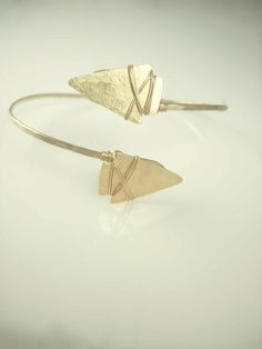 Hand Forged Arm Cuff with two hammered arrowheads wire wrapped onto arm cuff. Available in Gold + Fine Sterling Silver. HandMade with love XoXo
