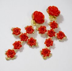 These statement gold cross clip-on earrings inspired by Byzantine designer collection and red flowers blossoms are made from gold tone cross embellished with red resin roses and flowers and red glass crystals. Finished with the clip-on fastening. These earrings are pretty heavy so if your ears cant hold that weight please consider smaller earrings :) Length 8cm/3.  PLEASE READ POLICIES BELOW:  SHIPPING  I am shipping via registered air mail (it takes 1-3 weeks in Europe and 2-6 weeks res...