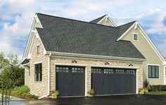 Include your garage door in you home's exterior color scheme. Designers of the BH&G 2015 Innovation Home painted Clopay Canyon Ridge Collection faux wood carriage house garage doors charcoal gray to match the roof and window color. www.clopaydoor.com