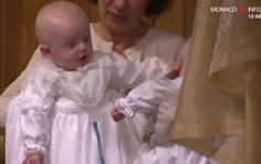 Prince Jacques playing with his twin sister Gabriella,  at their christening
