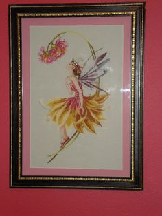 """""""Petal Fairy"""" by Mirabilia.  I stitched this for my daughter room.  It's the focal point in her room."""