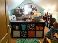 Small Attic Playroom Place For Kids With Black Polished Wooden Toys Storage Open Cabinets As Well As Kids Room Decor Plus Girls Bedroom Ideas, Something Special And Exciting To Organize A Boys Playroom: furniture, Interior, kids room
