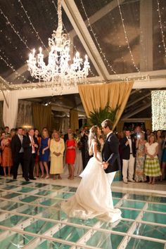 Wedding Reception over the pool dance floor: the first dance Photo Credit: Laura Negri Photography