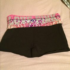 PINK Yoga shorts with multi colored band These PINK Yoga Booty shorts have a multi colored animal print band and glitter logo.  Super cute shorts ❤️ PINK Victoria's Secret Shorts