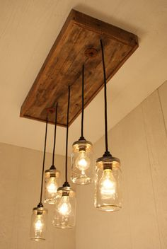 Beautifully Crafted Farmhouse Chandelier, Mason Jar Lighting, With Reclaimed Wood and 5 Pendants, homedecorationliv. deals in unique lighting system to make your best interior kitchen decoration like kitchen lighti. Decor, Rustic Lighting, Kitchen Lighting, Mason Jar Chandelier, Mason Jar Lighting, Light Fixtures, Jar Chandelier, Home Decor, Small Kitchen Lighting
