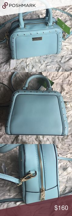 ⚜️SALE⚜️ Kate spade small rocki NWT. Kate spade Small Rocki. Helena street. Color blehydrnga. A light blue with gold accents. Removable crossbody strap. Blue interior with 1 slip pocket. Slight discoloration on bottom.  Dimensions  Bottom: 9 inches wide Top: 7 inches wide 7 inches tall 4 inches wide Handle drop 4 inches  🔴NO TRADES🔴 Also available in a light cream kate spade Bags Crossbody Bags