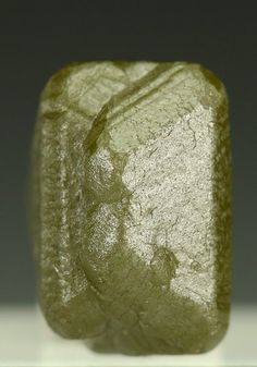 DIAMOND Macle Twin Kasai-Oriental, DR Congo (Zaire), Africa A neat crystal specimen of a Macle Twin Diamond with a triangular aspect, and an opaque light yellow brown colour. The Diamond measuring to 8mm, from the Kasai-Oriental area D. R. Congo. The area was extensively mined for placer Diamonds before the discovery of a number of Kimberlite pipes.