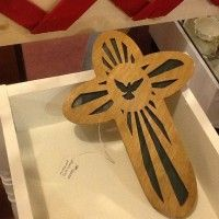 Hand carved wood cross with dove in the center.  Very precise cutting to do this! For sale at www.postyourpiece.com