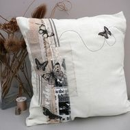 Pretty cushion cover appliqued with vintage fabrics and lace with printed and appliqued butterflies on a lovely cream cotton canvas. The cushion cover has a plain back with an envelope opening and comes complete with a polyester cushion inner. Measures...