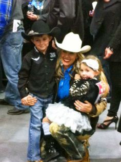 Brazile family hug, celebrating Trevor's 19th world title and Shada's second in the average at her first NFR!