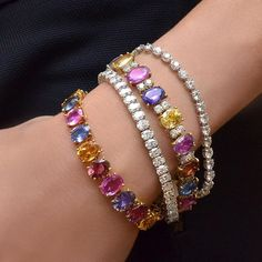 Add More Color To Your Year with these gorgeous multi color sapphire bracelets, and diamond tennis bracelets. set in 18 karat white and rose gold.
