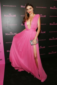 Miranda Kerr ❤︎, wears pink pĺunging dress, in an Emanuel Ungaro, at the Magnum 'Black & Pink' launch party in the 68th annual Cannes Film Festival on May 14, 2015 in Cannes, France. | Her Campus