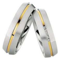 These unique solid Two Tone white-yellow-white Gold His and Her Matching Wedding rings are Satin finish.Price is for both bands.Her wedding band has 5 Round shiny diamonds.Total diamond weight is carat.Both wedding bands are wide. Solid Gold, White Gold, Matching Wedding Rings, Couple Rings, Round Diamonds, Wedding Bands, Rings For Men, Satin, Engagement Rings
