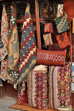 Tribal Rugs & Pillows (don't know the tribe...the photo was originally posted on a blog by a guy from South Africa)