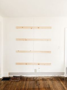Step by step tutorial on how to build an inexpensive shiplap fireplace using an electric insert. Transform your boring TV wall into a statement piece. Diy Fireplace Mantel, Fireplace Tv Wall, Build A Fireplace, Fireplace Built Ins, Shiplap Fireplace, Fireplace Inserts, Fireplace Design, Rustic Mantel, Bedroom Fireplace