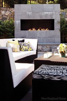 A modern fireplace...love the outdoor furniture too!