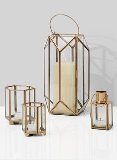 Our wholesale Gold Hexagon Glass Tea Light Holder are great for adding a gorgeous glow to your event. Shop today and save with our bulk pricing options. Gold Lanterns, Small Lanterns, Lantern Centerpieces, Lanterns Decor, Candle Lanterns, Pillar Candles, Wedding Centerpieces, White Candles, Porta Velas