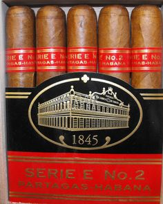The Partagas Serie E is a strong and complex medium-full Robusto Extra, long, of 54 ring gauge, and comes in a box of 5 cigars. With its top quality tobacco flavors, it predominates the palate with notes of earth and cedar and floral aro Cigars And Whiskey, Cuban Cigars, Whisky, Best Cigar Humidor, Cigar Gifts, Cigar Smoking, Smoking Pipes, Cigar Ashtray, Whiskey
