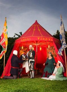 Stunning silk flags and banners from Alston Hall (an SCA household).  Also, LOOK at that TENT!