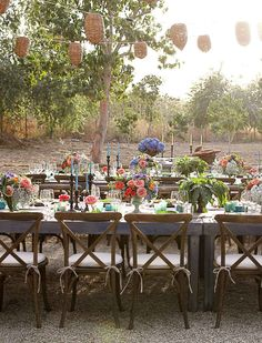 Love the table setting and the rustic feel of the chairs. Maybe just change the flowers to go with my colors.