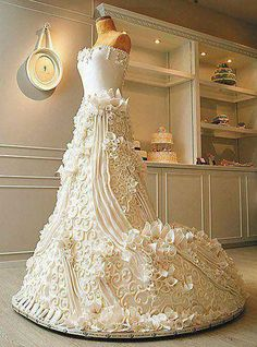 Wedding dress cake Interesting and creative food art. Visit us on Facebook for great recipes, health and weight loss tips and anything fabulous. https://www.facebook.com/fitfabuloushealthy1