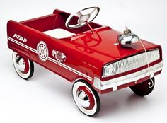 """Fire Chief pedal car with bell. MEASUREMENTS: 32"""". CONDITION: Restored."""