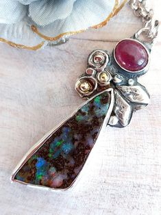 Necklace with Opal and Tourmaline Stones,Koroit Opal,Opal Necklace,Tourmaline Necklace,Pink Tourmaline,Artisan Necklace,Everyday Necklace I designed and handcrafted this beautiful Opal and Tourmaline pendant . I decorated the Sterling base with tiny silver spirals and 14k gold granules in them. The Tourmaline Necklace, Tourmaline Stone, Opal Necklace, Pink Tourmaline, Gemstone Earrings, Pendant Necklace, Handmade Jewelry Designs, Handmade Necklaces, Handcrafted Jewelry