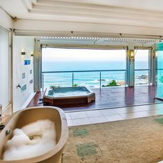 A bedroom with a bath, Jacuzzi and a picture perfect sea view! Diy Bathtub, Jacuzzi Bathtub, Outdoor Dining Furniture, Outdoor Decor, Rustic Bathtubs, Double Storey House, Simple Bathroom, Queen, Open Plan