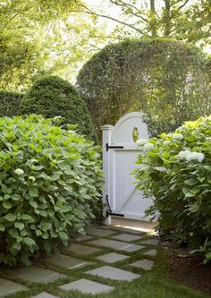 Painted White Gate - Round with Oval Cutout and Black Iron Hardware - Design by Jenny Wolf - Photo by Emily Gilbert