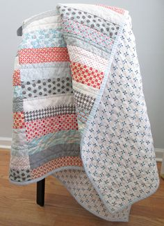 i am IN LOVE with this quilt backing!! especially paired with the top fabrics - perfection. (s.o.t.a.k handmade: strip quilt {finished})