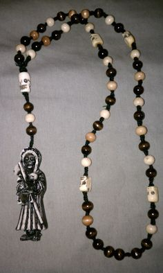 Something I discovered living in San Antonio was Santa Muerte, Holy Death.  This started in Mexico and has spread north.  It's a female personification of death, probably based on an Aztec goddess.  This is a beautiful Santa Muerte rosary.