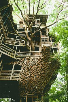"Minister's Treehouse in Crossville, Tennessee is a 100ft structure built by minister Horace Burgess, who says he started working on this giant treehouse after he had a vision. God spoke to him and said: ""If you build me a  treehouse, I'll see you never run out of material."" He spent the next 14 years building God's treehouse, using only salvaged materials. See more pics here…"