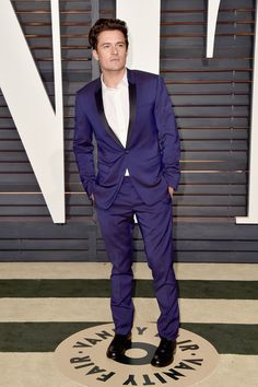 Orlando Bloom wearing a lighter navy Dior Homme wool tuxedo @ the Elton John AIDS Foundation Oscars Viewing Party 2015