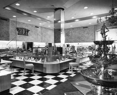 BULLOCK'S - SHERMAN OAKS:  Interior view of Bullock's Cosmetics department- done in pink and gold, it will offer women a wide choice. Photo dated: April 29, 1962.