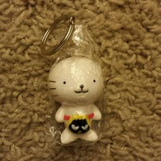 Sanrio Keychain - NWOT Brand new with wrapping Price is firm. Sale - Bundle 3 keychains together for $15. Sanrio Accessories Key & Card Holders