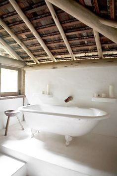 = white bath, stool and wood ceiling