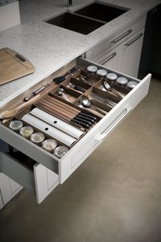 Sleek and stylish, walnut drawer dividers are the just the thing to keep you organized #drawer #dividers #custom #cabinets #storage #kitchen #organization #accessories