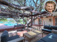 Peek into these Stunning Celebrity Backyards | SEAN PENN | The actor recently listed his 1960's style U-shaped Malibu home for $6.55 million. A short walk from the beach, Penn's 1.4-acre estate features a pool, a vine-covered outdoor entertaining area and a gorgeous rose garden.