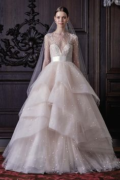 Long sleeve illusion waist full ballgown with horsehair layered skirt with silk ribbon sash