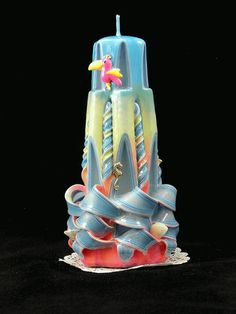 Check out this item in my Etsy shop https://www.etsy.com/listing/226548202/hand-carved-candle-sunset-lighthouse