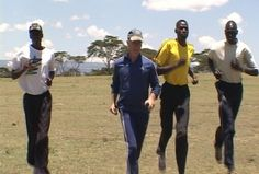"""Kenya's Elite Marathon and 10k Runners with Stan Cottrell in Kenya - Stan wrote: """"Some of Kenya's elite runners. This is a scene from our upcoming DVD """"Running Made Easy."""" These gentlemen were just as amazed with me as I was with them. They said, """"No one your age runs here. They are retired.""""  Being here was nothing short of a marvelous experience... (filming Running Made Easy)"""