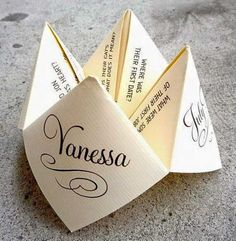Custom designed cootie catcher for tables at reception -- fun way to learn more about bride and groom wedding decorations cheap indoor Save Your Budget with Fun and Quirky Wedding Party Games Wedding Table Games, Wedding Games For Guests, Wedding Decorations, Wedding Trivia, Wedding Venues, Games For Weddings, Wedding Kissing Games, Kissing Menu, Wedding Ceremony